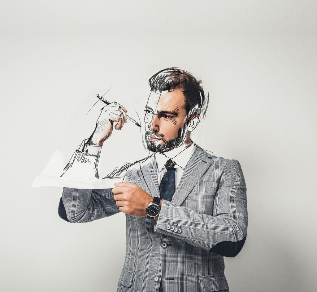 Homme tenant une feuille de papier de laquelle sa propre main sort pour se dessiner le visage